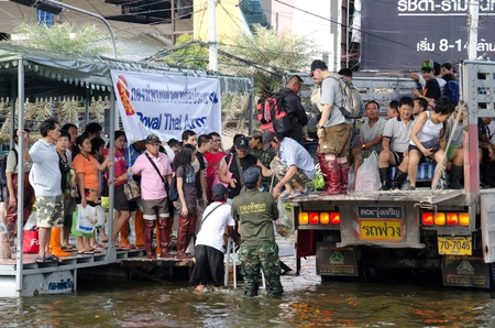 BANGKOK, THAILAND-NOVEMBER 13: Transportation of people in the streets flooded after the heaviest monsoon rain in 50 years in the capital on November 13, 2011 Phahon Yothin Road, bangkok, Thailand.