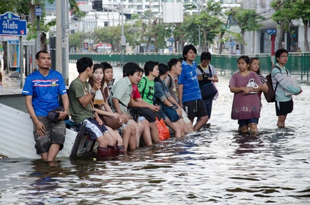 decades: BANGKOK THAILAND � NOVEMBER 13: People waiting of hight vehicles or boat  during its worst flooding in decades is a major disaster on November 13, 2011 in Bangkok, Thailand. Editorial