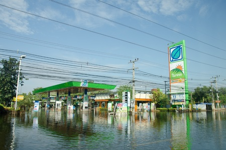 PATHUM THANI THAILAND – NOVEMBER 14: Gas station in Pathum Thani  during its worst flooding in decades is a major disaster on November 14, 2011  in Pathum Thani, Thailand.