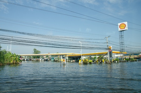 PATHUM THANI THAILAND � NOVEMBER 14: Gas station in Pathum Thani  during its worst flooding in decades is a major disaster on November 14, 2011  in Pathum Thani, Thailand. Stock Photo - 11200403
