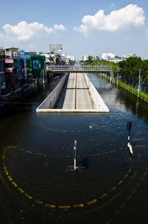 BANGKOK - NOVEMBER 13: A road tunnel dries and survives from the flooded area at Kaset - Navamin crossed roads during the massive flood crisis on November 13, 2011 Bangkok, Thailand. Stock Photo - 11215197