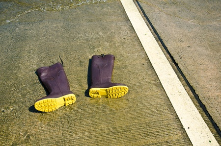 High boots on concrete. Stock Photo