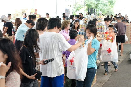 BANGKOK, THAILAND-NOVEMBER 27: Volunteers to help line up the bag to help the victims after the heaviest monsoon rain in 50 years in the capital on November 27, 2011 , Red Cross Bangkok, Thailand.