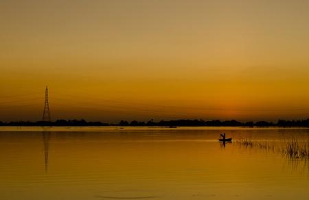 The fishermen were fishing in the lake. Stock Photo - 11385098