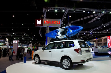 subaru: BANGKOK - DECEMBER 3: Subaru Forester 2.0x car with bicycle and boat on the roof on display at the 28th Thailand International Motor Expo on December 3, 2011 in Bangkok, Thailand.