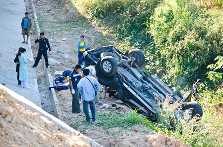 Phrae - DECEMBER 10: On the highway pickup truck crashes into the abyss on December 10, 2011 in Phrae, Thailand.  Stock Photo - 11564883