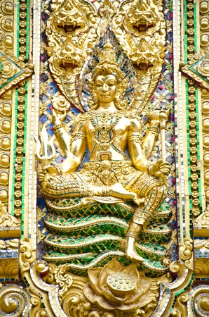 The golden Buddha statue. Sitting on the serpent. Stock Photo - 11799776