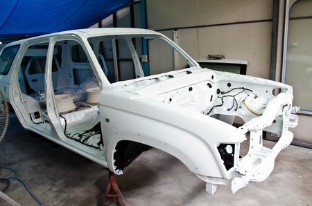 The chassis is made ​​of a white car waiting. photo