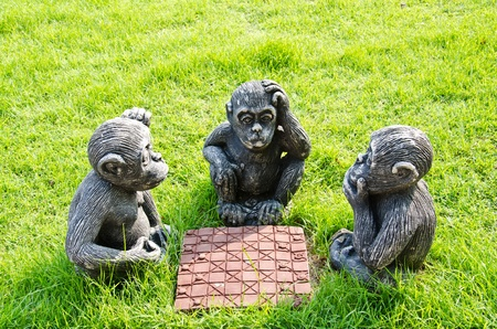 Doll monkey playing chess. photo