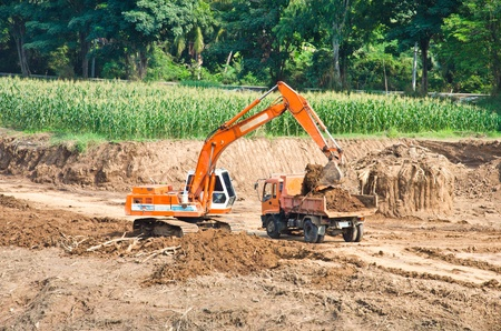 Heavy excavator loader at soil moving works at construction site