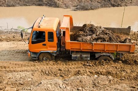 Heavy excavator loader at soil works is stuck in the mud. 写真素材