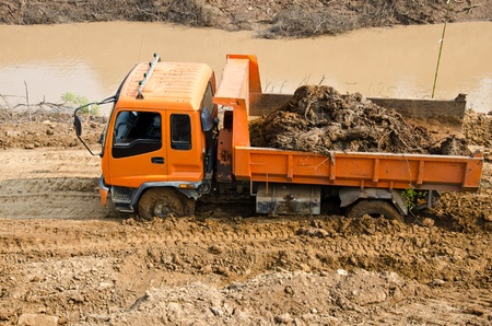 Heavy excavator loader at soil works is stuck in the mud. Stock Photo
