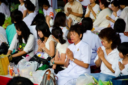 harity event: BANGKOK , THAILAND - MARCH 17: People Gives food offerings to a Buddhist monk on March 17, 2012 in Bangkok, Thailand. Thai traditional, people will make merit making by give food to monk