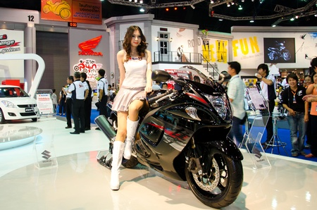 BANGKOK - MARCH 27: Unidentified model with motorcycle on display at The 33th Bangkok International Motor Show  on March 27, 2012 in Bangkok, Thailand.