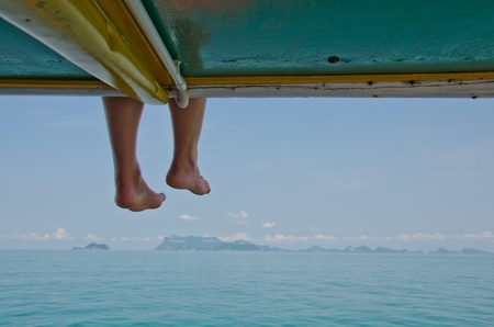 Legs of woman sitting on deck of the vessel Stock Photo - 13193739