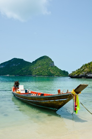 Long tail boat on the beach  Angthong National Marine Park, Suratthani province, Thailand Stock Photo - 13359846