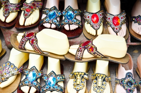 adorned: Shoes adorned with colorful stones