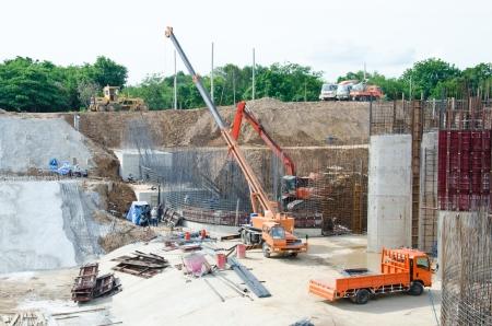 site: Crane standing on a construction site under construction floodgate
