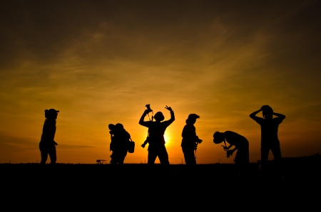 silhouette of friends photographer in sunset Stock Photo - 16380789