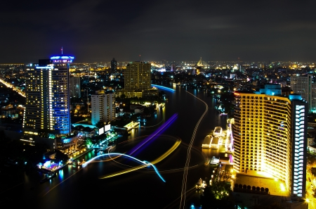 Bangkok City at Night, the light from of the ships in the river, Thailand. photo