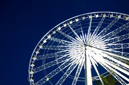 midway: White ferris wheel in twilight Editorial