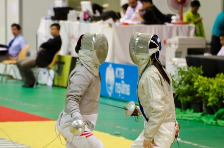BANGKOK - MARCH 10: Unidentified Fencing Athletic fight against of Asian Junior & Cadet Fencing Championships 2013 on March 9, 2013 in Bangkok, Thailand.