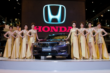 BANGKOK - MARCH 26 : The Honda Accord car with unidentified model on display at The 34th Bangkok International Motor Show 2013 on March 26, 2013 in Bangkok, Thailand.