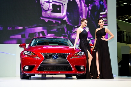 BANGKOK - MARCH 26 : The Lexus IS 300h car with unidentified model on display at The 34th Bangkok International Motor Show 2013 on March 26, 2013 in Bangkok, Thailand.