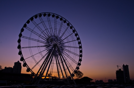 The ferris wheel in twilight.