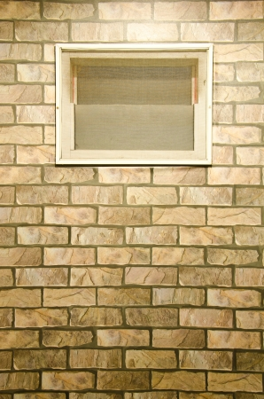 solid wire: Window on the wall made of brown bricks