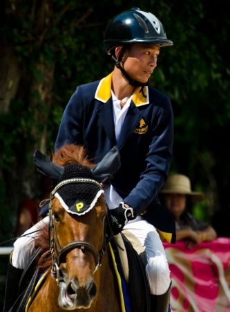CHON BURI, THAILAND - APRIL 27: Unidentified Equestrian with horse at The 11th competition Nawamintr Cup Queens Cup on April 27, 2013 in Chon Buri, Thailand.