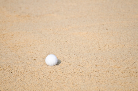 Golf ball in a sand trap