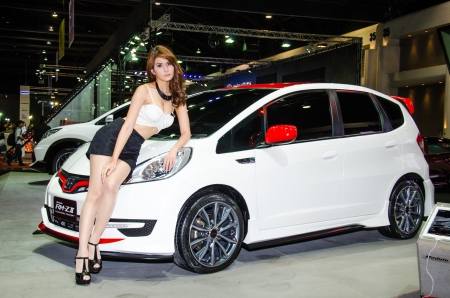 BANGKOK - JUNE 20 : Unidentified model with Honda Modulo RM-Z II car on display at Bangkok International Auto Salon 2013 Exciting Modified Car Show on June 20, 2013 in Bangkok, Thailand.