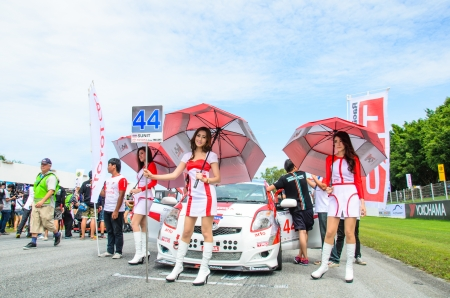 CHOUN BURI - AUGUST 18  Unidentified model with racing car on display at the Thailand Super Series 2013 Race 4 on August 18, 2013 at the Bira International Circuit Pattaya, Thailand