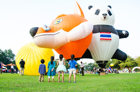 CHIANG MAI - DECEMBER 7: Unidentified people on display at The Thailand International Balloon Festival 2013 on December 7, 2013 in Chiang Mai, Thailand.
