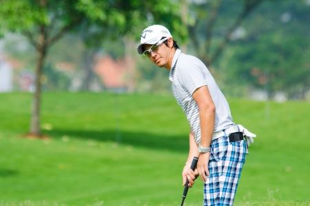 ishikawa: CHONBURI - DECEMBER 14 : Ryo Ishikawa of Japan player in Thailand Golf Championship 2013 at Amata Spring Country Club on December 14, 2013 in Chonburi, Thailand.