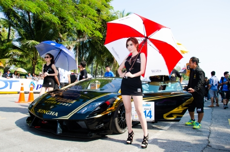 CHON BURI - DECEMBER 22:  Unidentified model with Lamborghini car on display at the Bangsaen Thailand Speed Festival 2013 Race 8 on December 22, 2013 at the Bangsaen street circuit, Thailand
