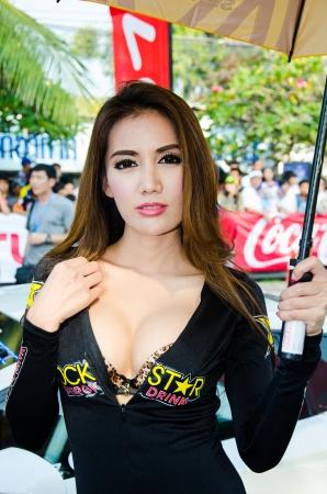 CHON BURI - DECEMBER 22:  Unidentified model with racing car on display at the Bangsaen Thailand Speed Festival 2013 Race 8 on December 22, 2013 at the Bangsaen street circuit, Thailand