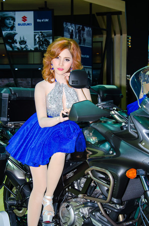 BANGKOK - MARCH 25: Wallaya Nivornkarn with Suzuki motorbike on display at The 35th Bangkok International Motor Show on March 25, 2014 in Bangkok, Thailand.