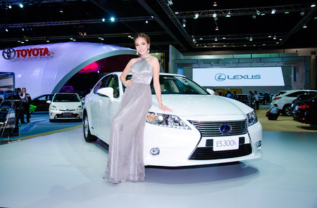 BANGKOK - MARCH 25: Unidentified model with Lexus ES 300h car on display at The 35th Bangkok International Motor Show on March 25, 2014 in Bangkok, Thailand. Stock Photo - 27061833