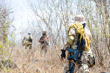 patrolling: Soldiers are patrolling to protect the stronghold.