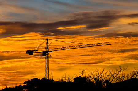 Industrial construction cranes silhouettes at sunrise. photo