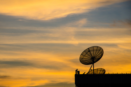 Satellite dish in twilight at sunset. photo