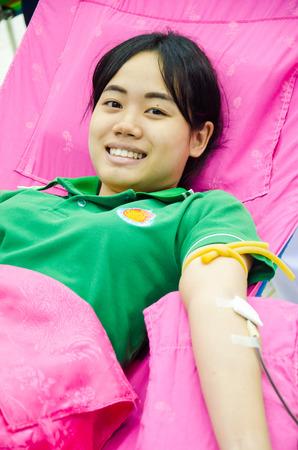 singburi: SINGBURI - JUNE 12 : Unidentified blood donors in World Blood Day 2014 at Sing Buri Red Cross office on June 12, 2014 in Singburi, Thailand.