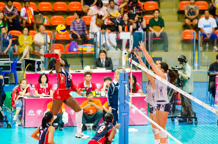 BANGKOK - AUGUST 17: Bathania De La Cruz of Dominican Republic Volleyball Team in action during The Volleyball World Grand Prix 2014 at Indoor Stadium Huamark on August 17, 2014 in Bangkok, Thailand.