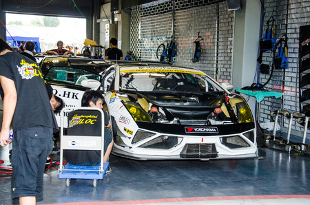 buriram: BURIRAM - OCTOBER 4:  Lamborghini racing car in pit on display at The 2014 Autobacs Super GT Series Race 7 on October 4, 2014 at Chang International Racing Circuit, Buriram Thailand.