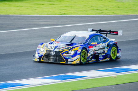 buriram: BURIRAM - OCTOBER 4: Juichi Wakisaka and Yuhi Sekiguchi with WedsSport ADVAN RC F on display at The 2014 Autobacs Super GT Series Race 7 on October 4, 2014 at Chang International Racing Circuit, Buriram Thailand Editorial