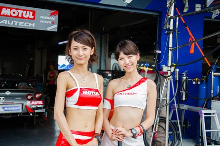 buriram: BURIRAM - OCTOBER 4: Unidentified Race Queen of Japan with racing car on display at The 2014 Autobacs Super GT Series Race 7 on October 4, 2014 at Chang International Racing Circuit, Buriram Thailand