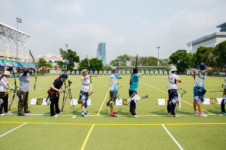 BANGKOK -MARCH 19: Unidentified archers in a row and shootin 2015 Asia Cup-World Ranking Tournament (stage II) at Hua Mak Sports Complex on March 19, 2015 in Bangkok, Thailand.