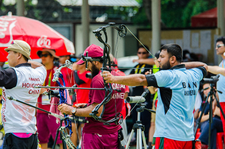 sports complex: BANGKOK -MARCH 19: Unidentified archers in a row and shootin 2015 Asia Cup-World Ranking Tournament (stage II) at Hua Mak Sports Complex on March 19, 2015 in Bangkok, Thailand.